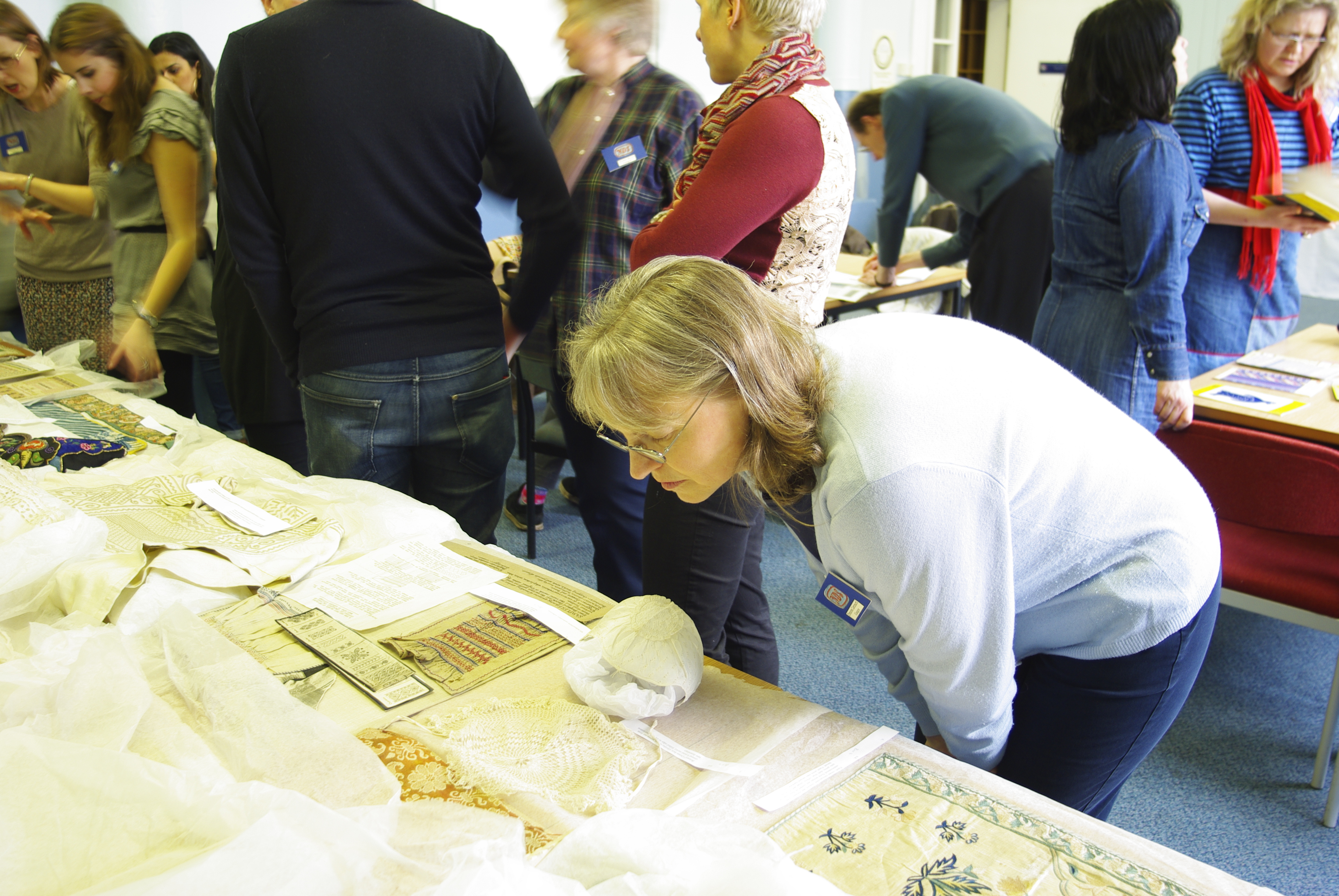 Frances Lennard, senior lecturer in Textile Conservation at the University of Glasgow, inspecting an item from ECA's NDS collection