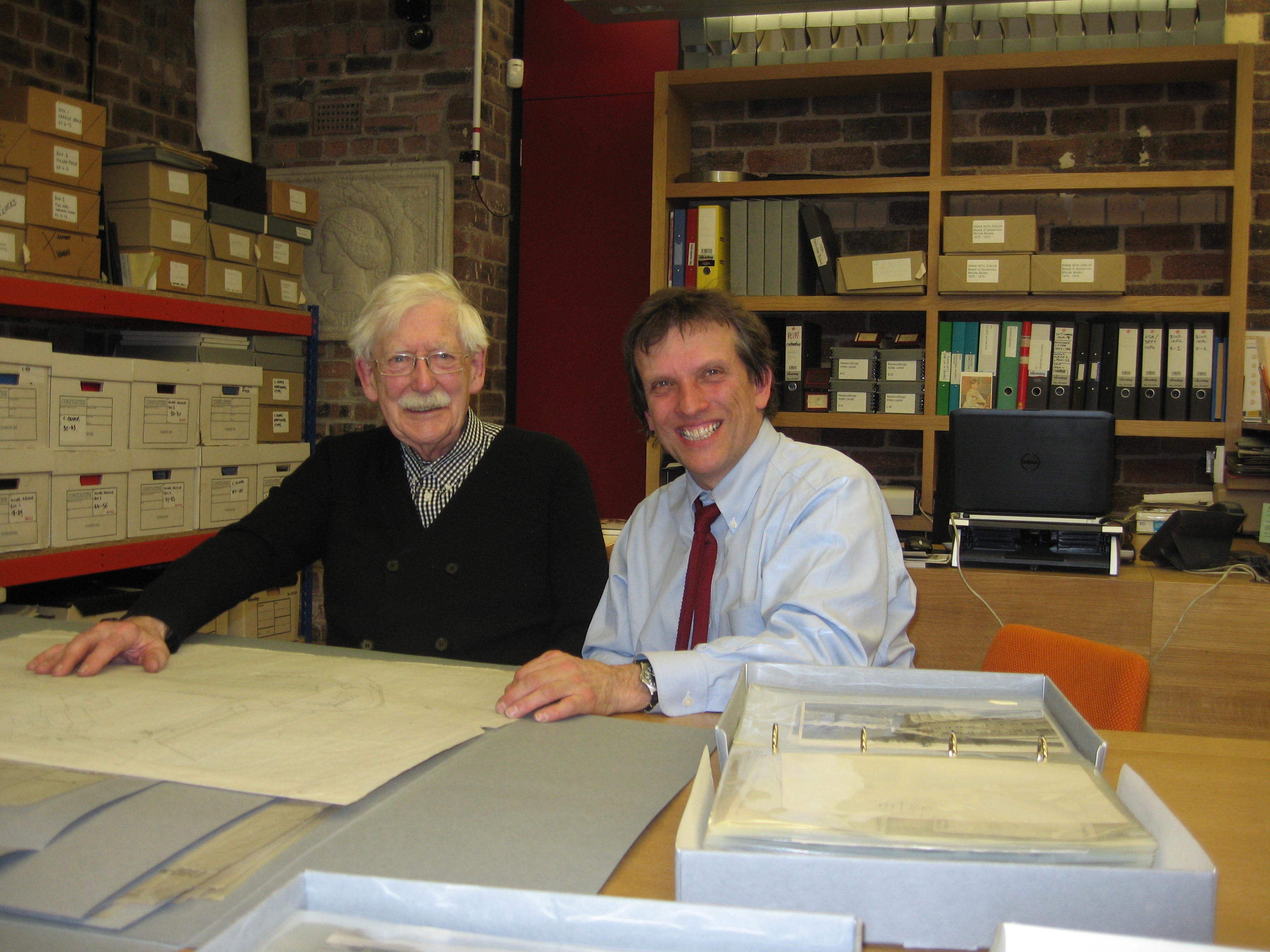 Andy MacMillan (left) and broadcaster Jonathan Glancey examining Gillespie, Kidd & Coia architectural drawings in our office