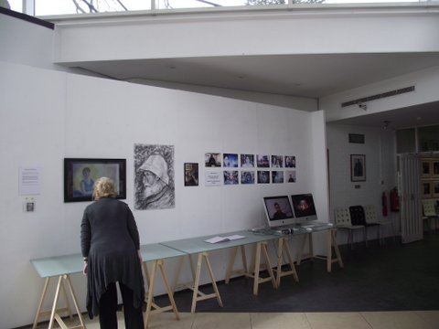 An exhibition by five UCA students. The images in the far right and on the screen are still shots from the Maidstone Oral History Project, put up by Fine Art student Joanna Robinson, recording memories of ex staff and students from the Maidstone College of Art.