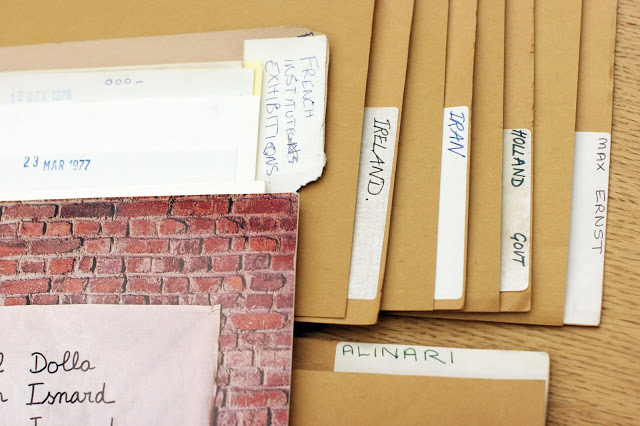 his is a photo of some of the original folder labels containing outreach to other countries and international artists.