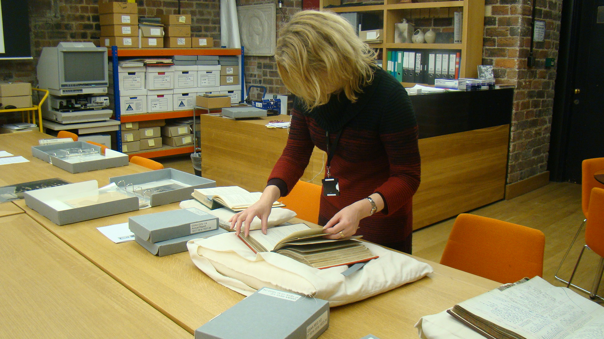 Alison Brown, curator of European Decorative Art at Glasgow Museums, examining items from our archives