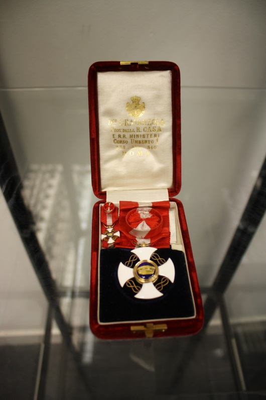 Cross of a Knight Officer Medal and Tie Pin awarded to Newbery, The Glasgow School of Art Archives and Collections, Archive reference NMC 900.