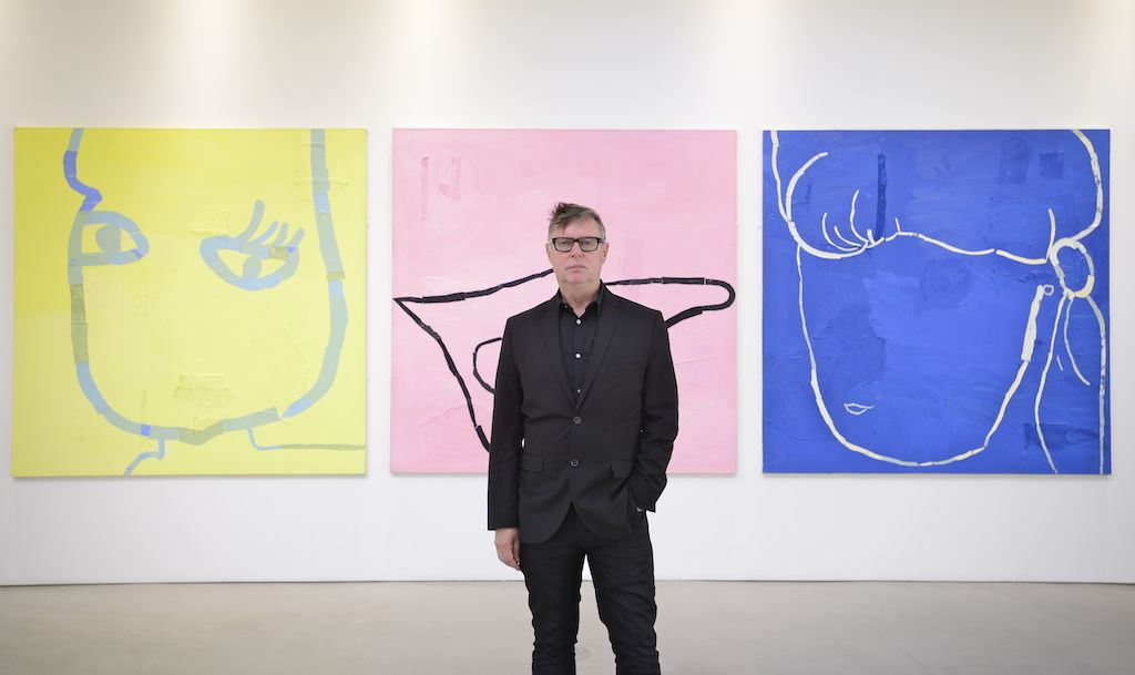 "Fraser Taylor with his exhibition ""Bodies of Work"" at House for an Art Lover in 2015. Image courtesy of House for an Art Lover."