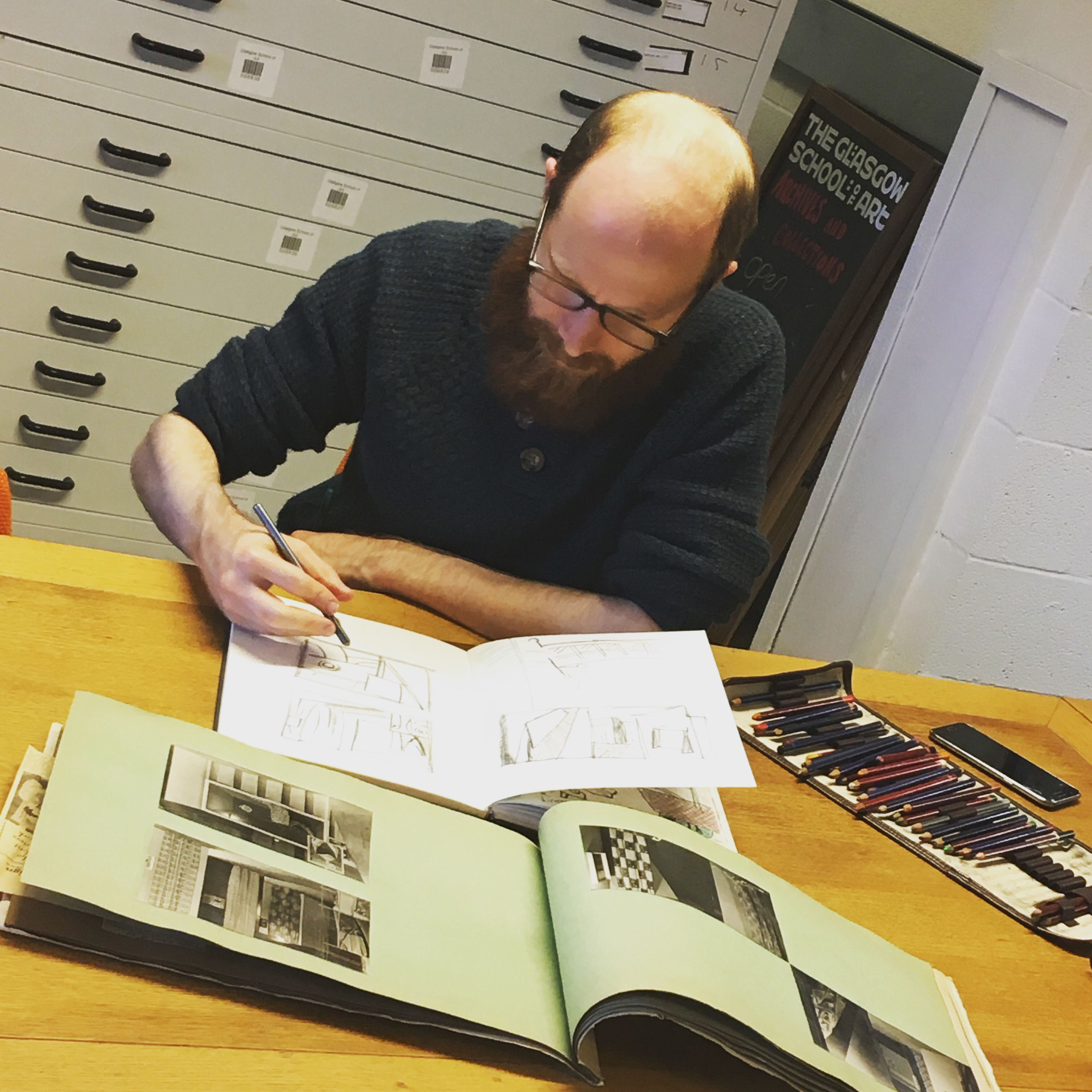 Peter sketching away in the reading room